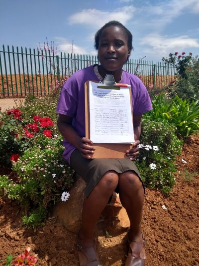 South African woman asking for signatures on petition to support inclusive education.