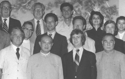 black and white photograph of people posing for photo with dignitaries in China