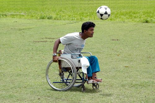 man in wheelchair playing soccer